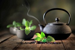 peppermint tea and kettle on a table