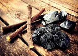 licorice candies and roots on a wooden table